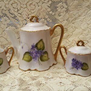 Tea set with purple flowers