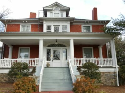 front of Chestnut Street house, red with white banisters