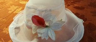 White hat with red flower