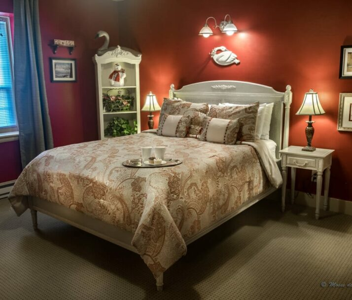 bed with red painted walls, tray on bed