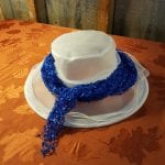 white hat with blue scarf