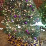Christmas tree decorated with purple ornaments