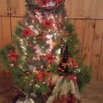 Christmas tree decorated with poinsettias