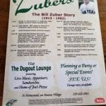 The back of the menu shares the Bill Zuber Story.