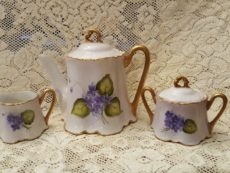 Tea set with purple flowers