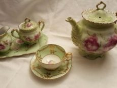 green teaset with pink flowers