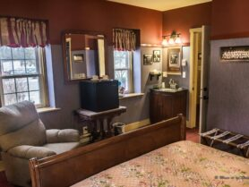 #2 The Major Leaguer room with sleigh bed, recliner, small fridge