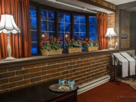 #6 The Red Carpet Room with flowers on window sill and lamps