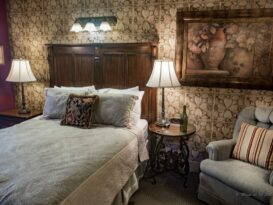 #7 The Vintner room with bed and recliner