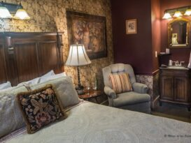 #7 The Vintner room with bed, recliner and vanity sink