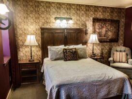 #7 The Vintner room with bed, recliner, lamps