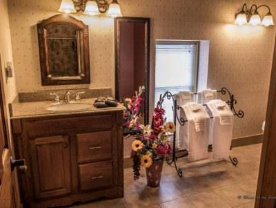 Walnut Grove bathroom with sink and white towels