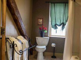 bathroom with large wood beam