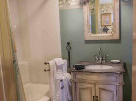 bathroom with vanity, tub