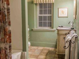 Bathroom with green walls, bathtub