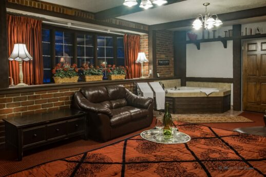 #6 – The Red Carpet Room with red carpet, sofa, lamps and tub