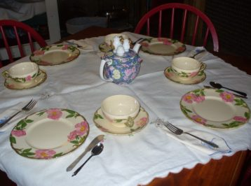 tea set with pink flowers, blue teapot