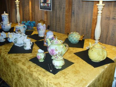 Several tea sets of various types and colors