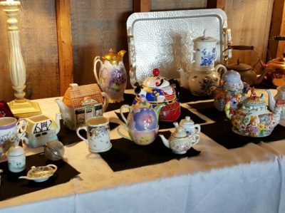 various teapots on table
