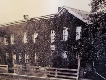 old picture of Zuber's with ivy on walls