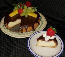 chocolate covered cheese cake with slice cut out