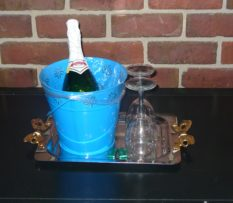 champagne in blue bucket and glasses