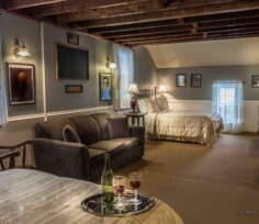 Walnut Grove room with beds, sofa, rocker
