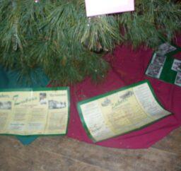 tree with Zuber's brochures underneath