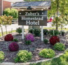 Zuber's Homestead Hotel entrance sign and flowers