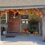 Front of Zuber's Homestead Hotel decorated in fall decor