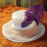 white hat with purple feather
